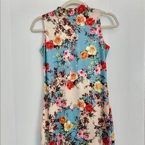 Multi colored floral print body con dress